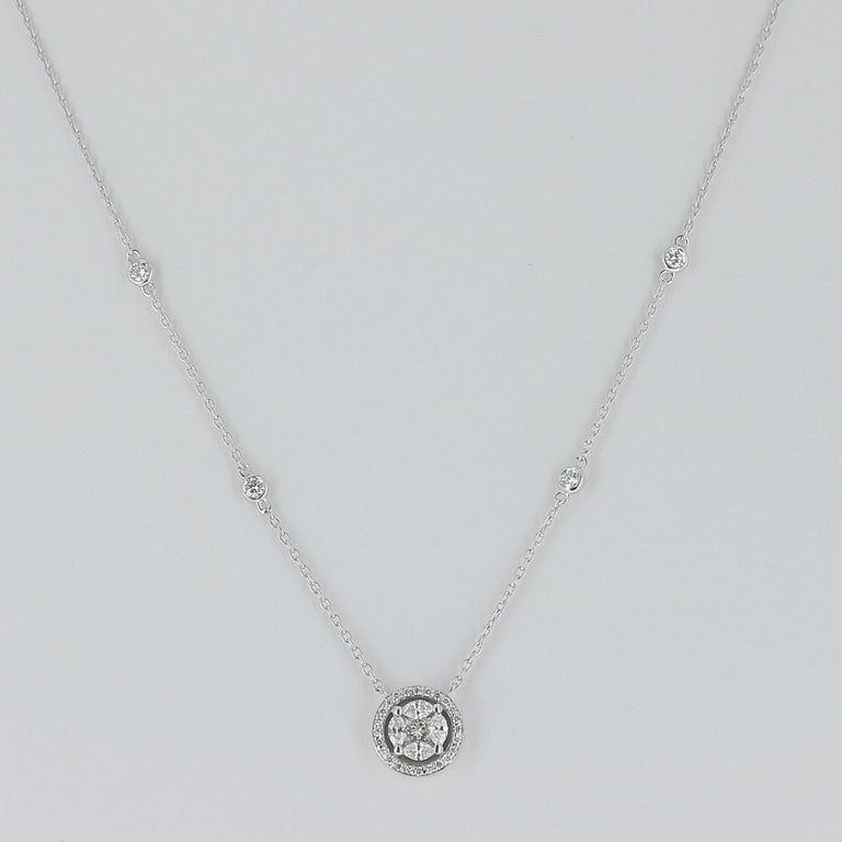 An amazing marquise pendant necklace set with 4 Marquise Diamond and Round Diamonds weighing 0.57 Carats. The necklace is set with 4 Brilliant Diamond and measure 43 Cm. The diamonds are GVS grade.  The Chain is in 18K gold. The Clasp is double
