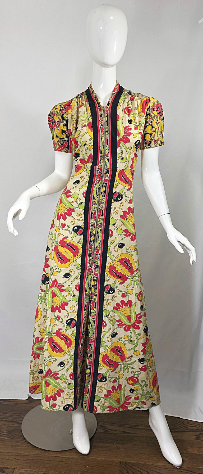 Amazing vintage 1940s Botanical Asian inspired linen and cotton maxi dress! Features vibrant colors of red, green, yellow, black and beige. Full metal zipper up the front to control cleavage. Chic slightly puckered puff sleeves. Very well made, with