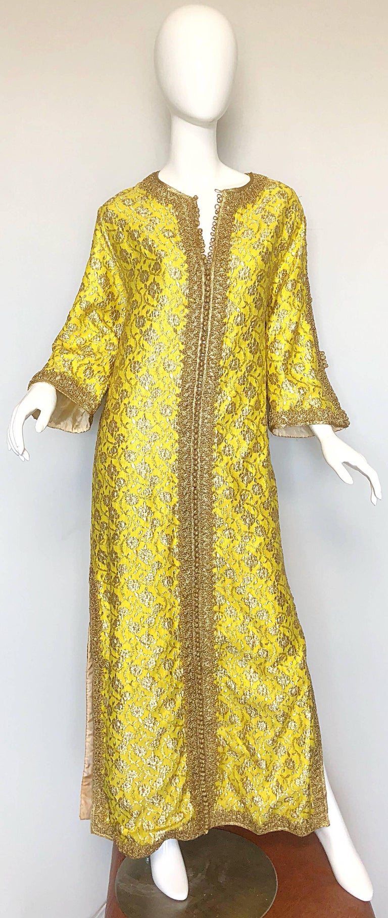 Amazing 1960s Moroccan couture yellow and gold silk brocade kaftan gown! Features a wonderfully hand stitched silk brocade. Gold embroidered trim down the front center features hundreds of gold hand woven functional buttons. Open seams on the outter
