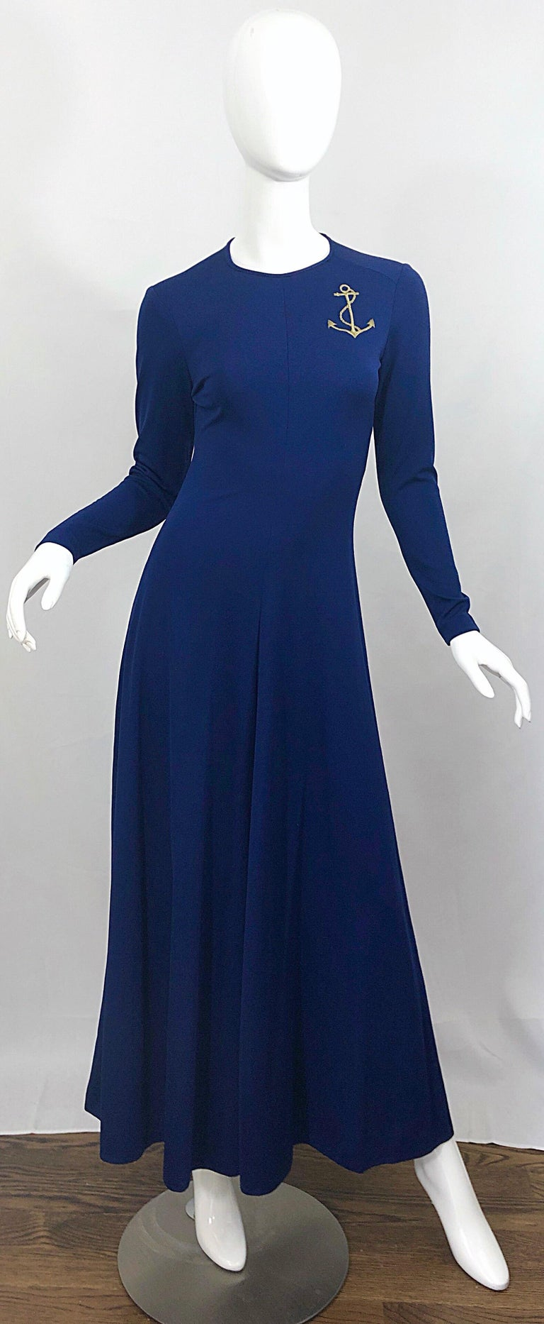 Amazing vintage 70s navy blue + gold anchor patch long sleeve jersey maxi dress! Perfect navy blue color matches anything, and is great all year. Gold anchor patch above left breast. Sleek tailored fit, with a forgiving fuller skirt. Hidden zipper