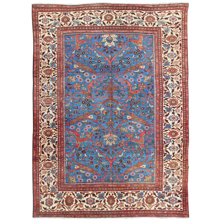 Amazing Antique Persian Sultanabad Rug in a Unique Persian Blue Background For Sale