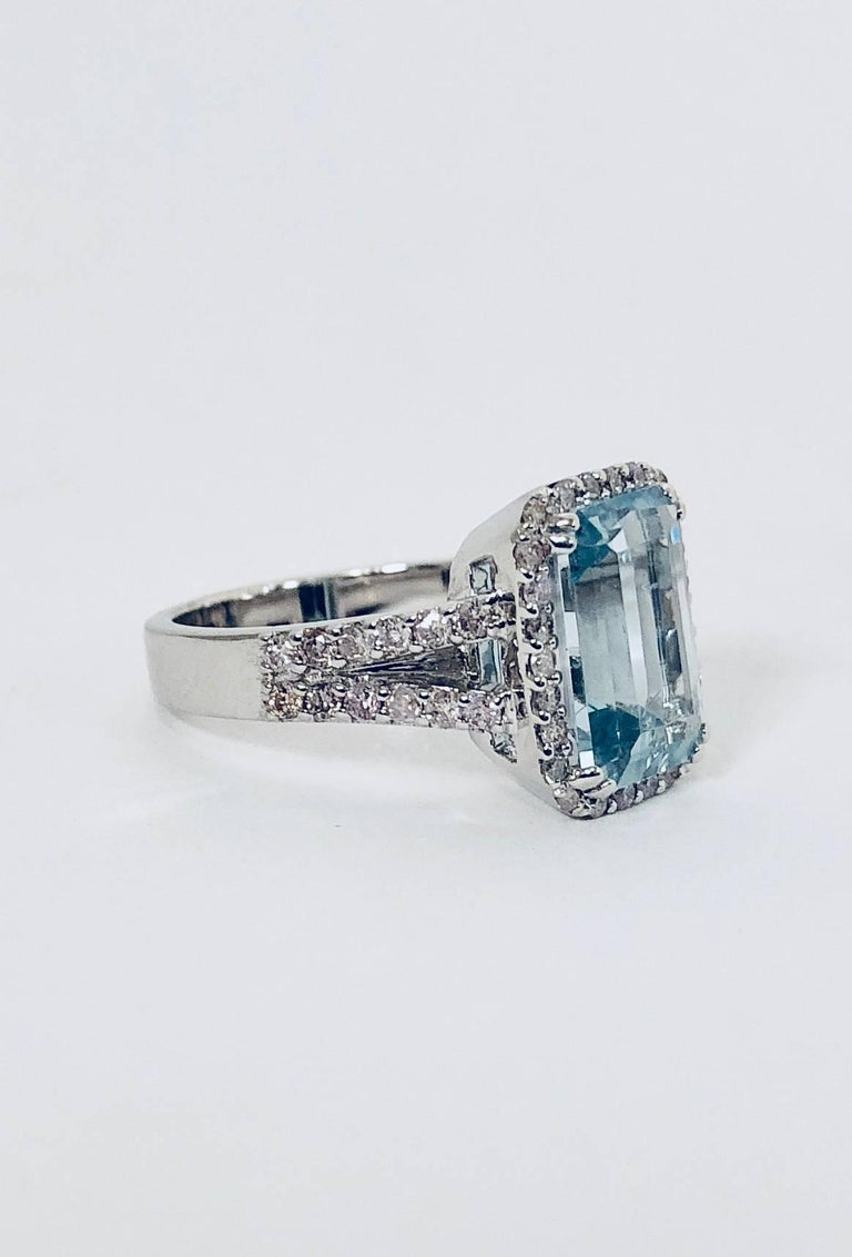 Perhaps one of the softest, most ladylike combinations in all of fine jewelry.  Beautifully crafted in 18 karat white gold this ring features  an emerald cut aquamarine weighing 2.43 carats, embraced by a white round diamond micro pave halo that