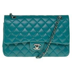 Amazing Chanel 2.55 handbag in green quilted lamb leather, Silver hardware