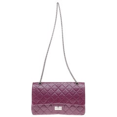 Amazing Chanel 2.55 Reissue handbag in plum quilted leather