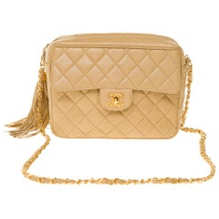 Amazing Chanel Camera front pocket crossbody bag in beige quilted leather, GHW
