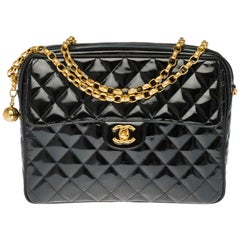 Amazing Chanel Camera shoulder bag in black quilted patent leather, GHW