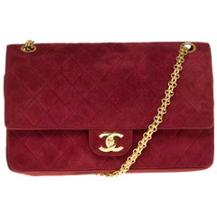 Amazing Chanel Classique handbag in red suede and gold hardware