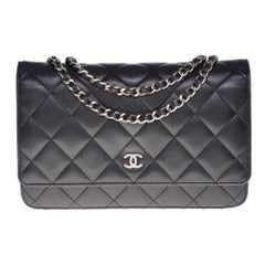 Amazing Chanel Wallet on Chain (WOC) shoulder bag in black quilted leather, SHW