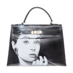 "Amazing creation ""Audrey Hepburn"" on Kelly 32 cm handbag in black calfskin"