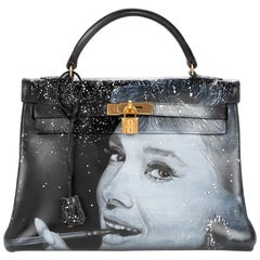 "Amazing creation ""Audrey Hepburn#47"" on Kelly 32 cm handbag in black calfskin"
