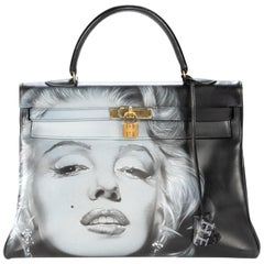 "Amazing creation ""Marilyn Monroe#46"" on Kelly 35 cm handbag in black calfskin"