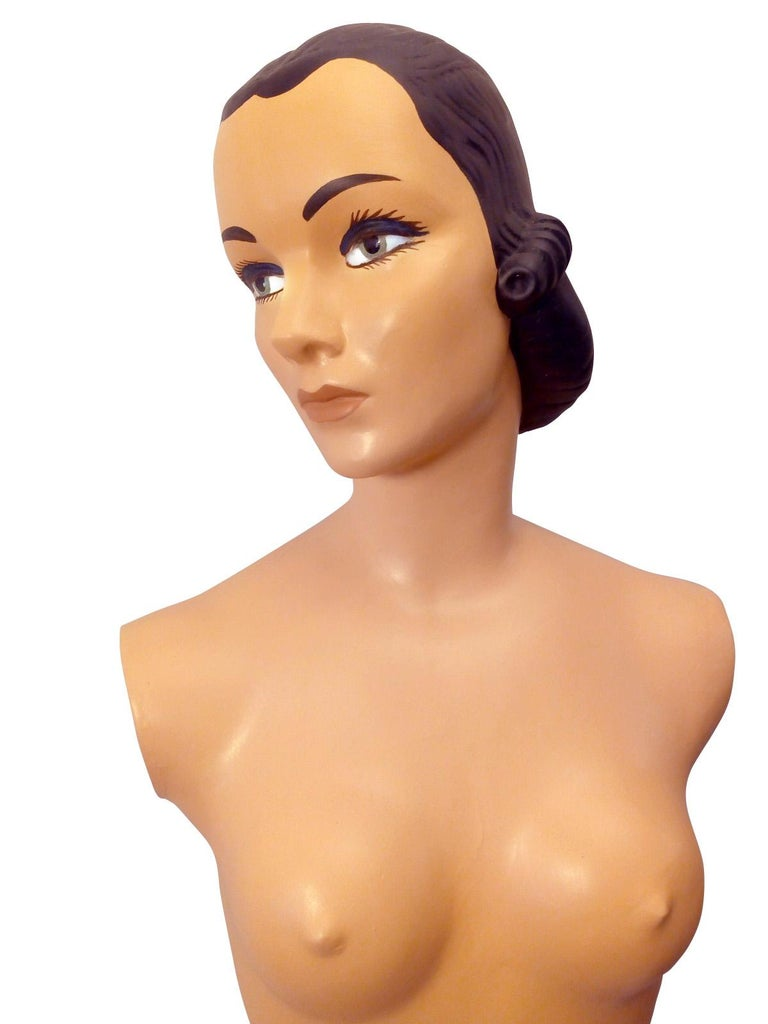 Amazing plaster and mesh female mannequin from the 1950s. Originally full size with limbs. Unfortunately the arms and legs were damaged beyond repair, it has been restored and mounted on a specially manufactured metal Stand. The face of the