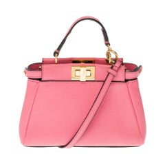 Amazing Fendi Micro Peekaboo shoulder bag in pink leather and gold hardware