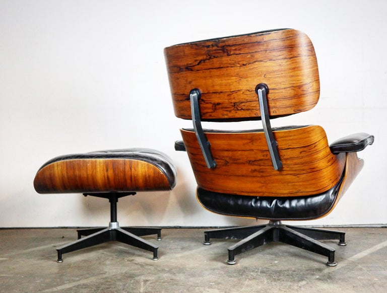 Gorgeous Herman Miller Eames lounge chair and ottoman. Spectacular color and wood grain pattern. Replaced shock mounts ($600 value) and original cushions. Signed with Herman Miller rags and guaranteed authentic.