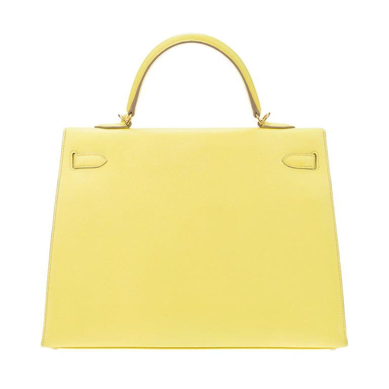 Stunning and Rare Hermes Kelly 35 cm lemon yellow Epsom leather handbag, gold metal trim, saddle stitches, yellow leather handle, removable shoulder strap handle in yellow leather for hand or shoulder support.  Shut down by flap. Inside lining in