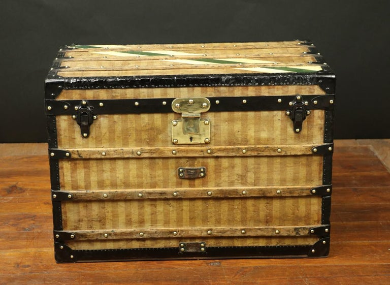 LOUIS VUITTON, 1870/1890 Louis Vuitton Striped Canvas Trunk • Lock is made of solid brass • Its handles are made of steel, like the rest of the jewellery 'clasps, angles...) • Interior has been redone, • Original label • An underside wooden slat has