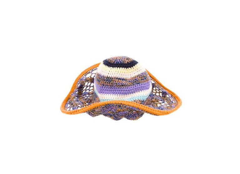 A great look for day. An extraordinary crochet knit hat in signature Missoni style.  This is a stunning Missoni hand-crocheted hat in beautiful colors.  It features a flexible brim. Due to a hidden flex wire which will allow you to shape the hat in