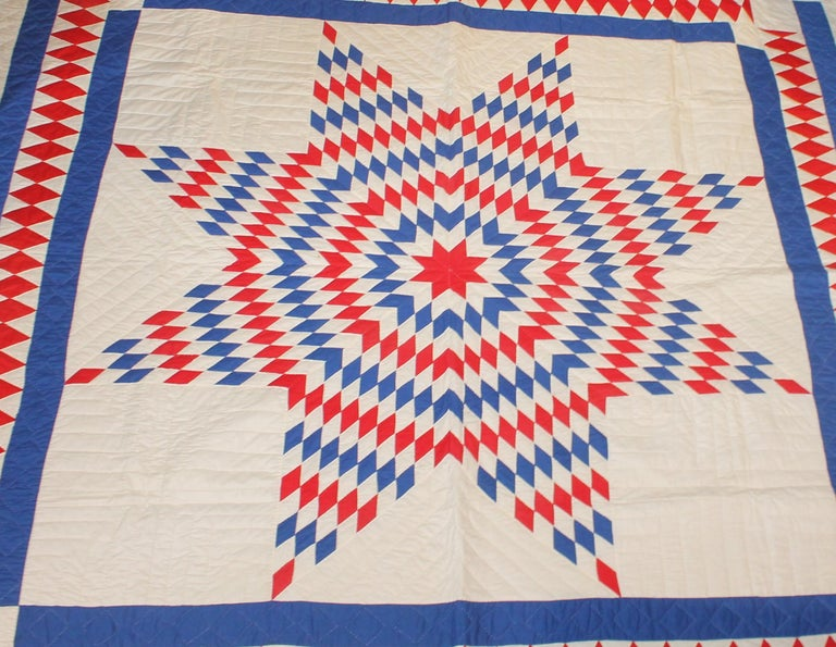 This fantastic red, white and blue star quilt from Pennsylvania has a wonderful diamond border. The piecework is very good and fine quilting. The condition is mint.