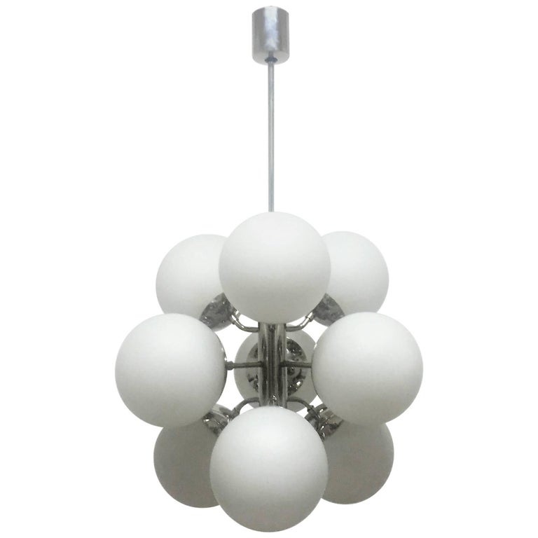 Amazing set of Mid-Century Modern Sputnik chandeliers with nine white glass globes hanging on nickelled, polished metal frame.