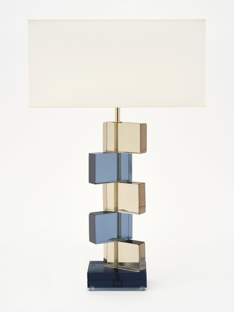 Amber and blue Murano glass geometric lamps signed by maestro Alberto Dona. We love the stacked block effect of the hand blown glass elements. They have been newly wired to fit US standards.