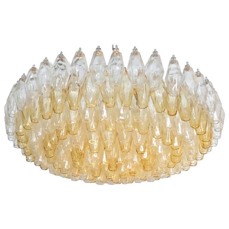 Italian modern chandelier shown in amber and clear polyhedron / polyhedral shaped Murano glass on white enameled metal frame / Made in Italy This fixture is fully customizable with various glass colors and metal finishes Please inquire for custom