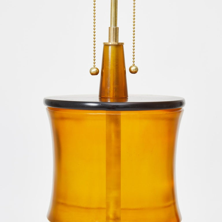 """A pair of table lamps with amber and brown transparent cast resin sections forming bamboo-shaped lamp bases. Each lamp can accommodate two medium base light bulbs. Designed by David Duncan Studio and fabricated in New York City.  Base 21"""" To shade"""