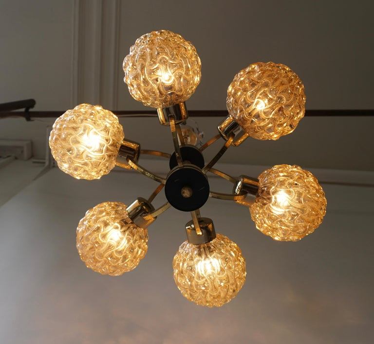 Beautiful bubble glass chandelier or pendant light designed by Helena Tynell for Glashu¨tte Limburg. A design Classic, the amber colored or toned hand blown glass gives a wonderful warm glow.   Helena Tynell is a finish glass and ceramics
