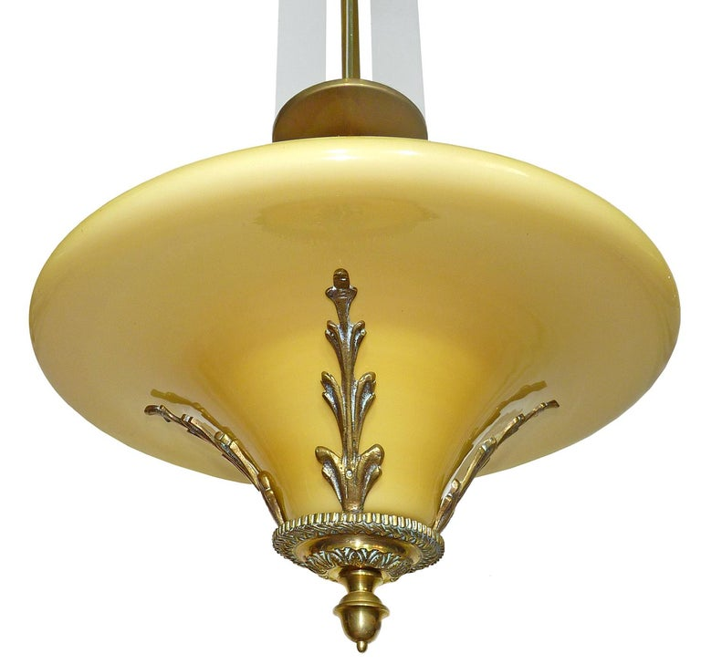 Antique Yellow French Art Deco or Art Nouveau bronze and opaline glass hanging chandelier in the style of petitot with four frosted glass strips. Beautiful age patina Measures: Diameter 15 in / 36 cm Height 36 in / 90 cm Weight 7 lb. (3