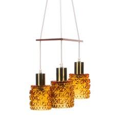 Amber Glass Fixture 1960s Scandinavian Lamps with Brass and Teak Crossbar