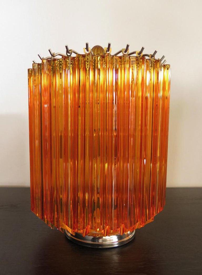 Magnificent pair of table lamps, 24 amber quadriedri for each lamp. Elegant object of furniture. Period: late 20th century Dimensions: 15 inches (38 cm) height; 10.50 inches (27 cm) diameter. Dimension glasses: 11 inches (28 cm) height Light