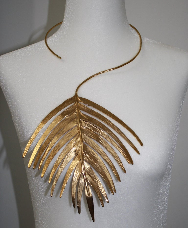 24KT gilded brass limited serie. Metal is very flexible allowing for adjustment around the neck as well as on the bust.
