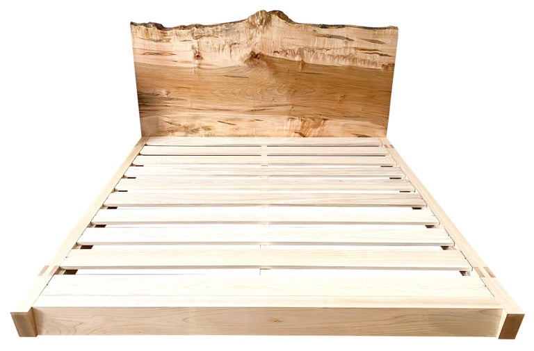 New York Heartwoods' king sized Perri Bed has a solid live-edge slab headboard and is inspired by the timeless elegance of Asian and Mid-Century Modern design. Each is handcrafted using traditional joinery techniques and breaks down for easy