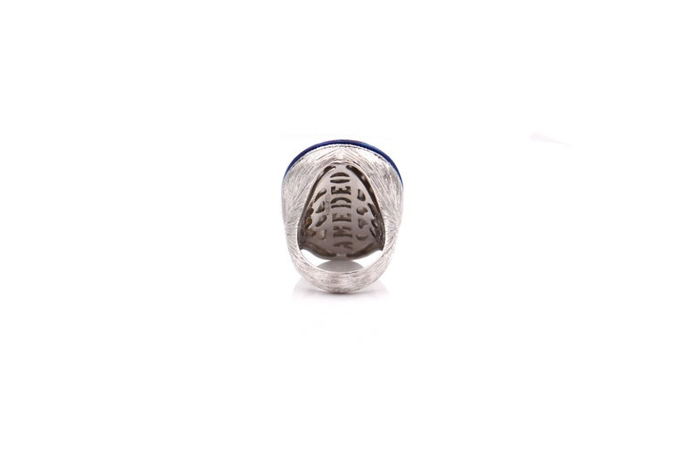 30mm agate hand-carved, set on sterling silver, white rhodium and titanium with 0.25cts of blue sapphires.