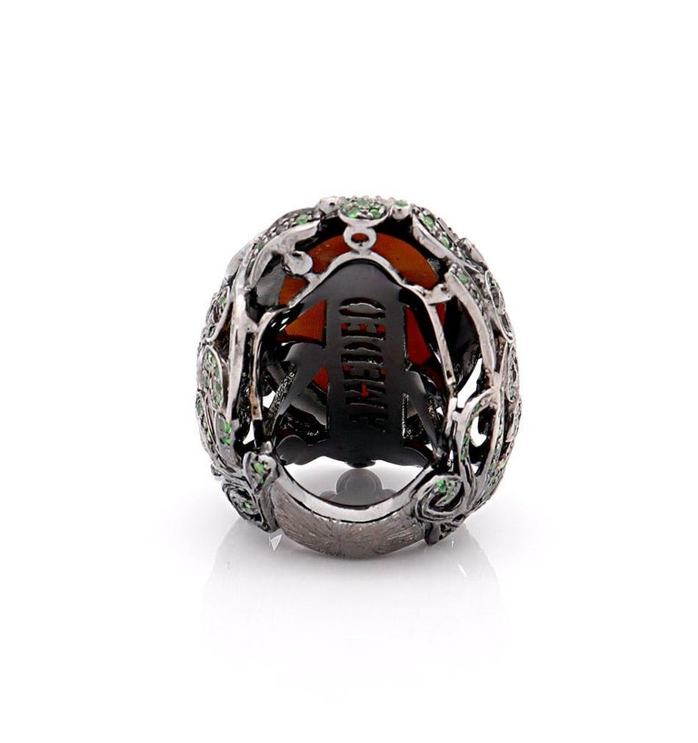 40mm sardonyx shell cameo hand-carved set on sterling silver, black rhodium with 0.68cts of black diamonds and 3.07cts of tsavorites.