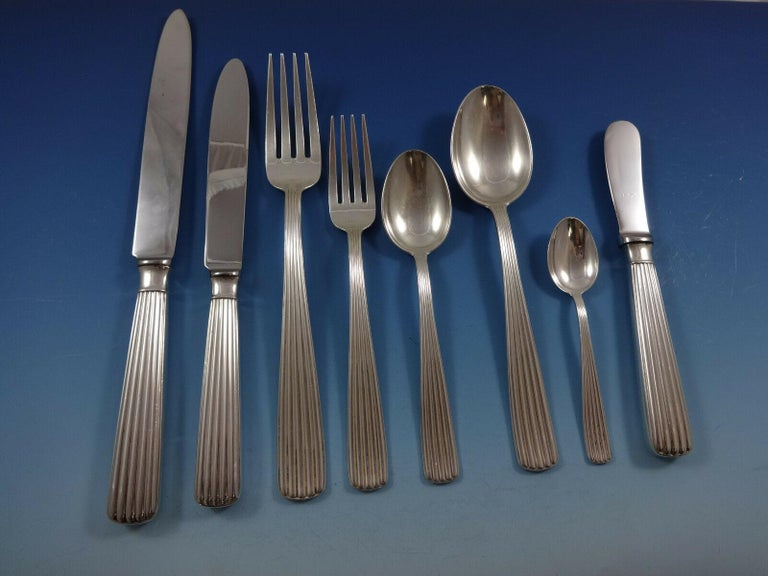 America by Schiavon This pattern is reminiscent of the pattern Bernadotte by Georg Jensen. The dinner knife and fork are extra large, European size, impressive!  This 67 piece sterling silver AMERICA BY SCHIAVON set includes:  8 large dinner knives,