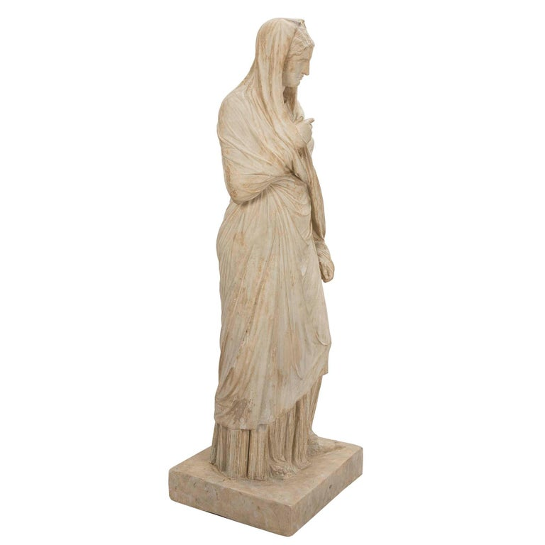 A most elegant American 19th century plaster statue of a classical maiden signed PP Caproni & Bro. Boston. The beautiful maiden is raised by a square base and is draped in wonderfully executed classical attire. Fabulous detail in the creases and