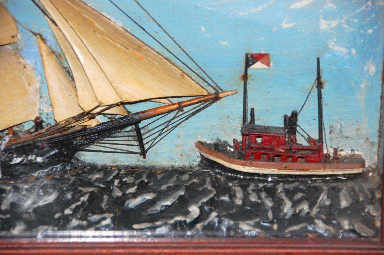American 19th century ship diorama of a barkentine and tugboat. The ships are all painted wood and the sea is plaster. The original walnut frame has never been refinished. Probably Maine made.