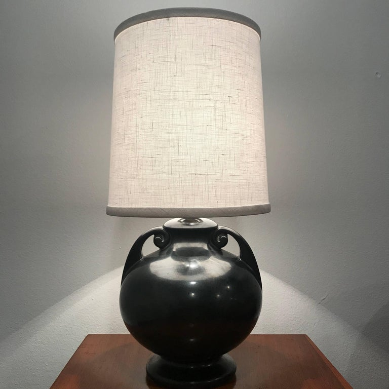 A beautiful 1930s ceramic Art Deco urn table lamp in a black graphite color glaze. Newly rewired.