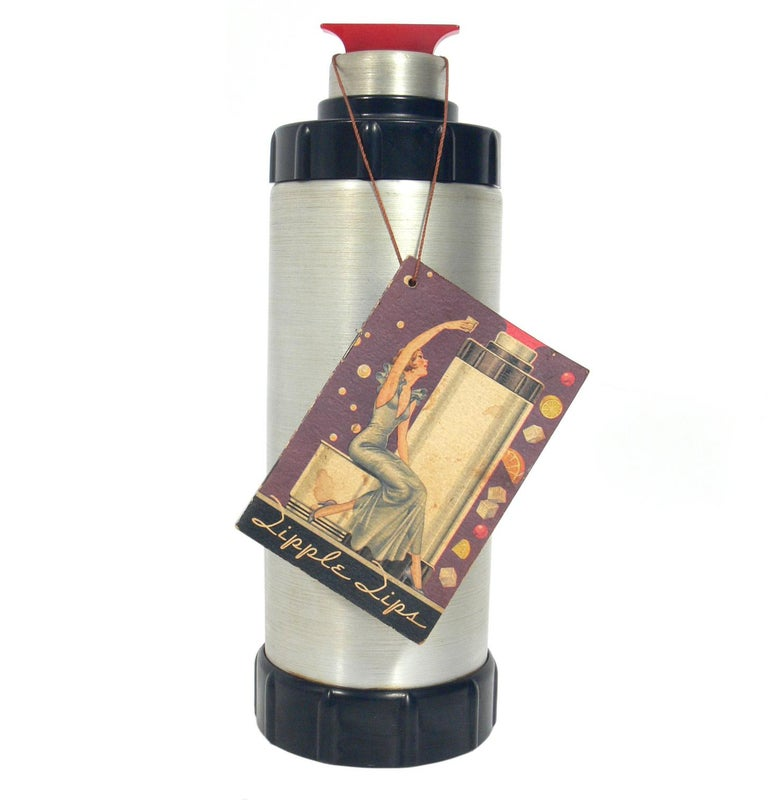 American Art Deco cocktail shaker, designed by Ralph Kirchler for West bend aluminium company, circa 1930s. Beautiful Art Deco design in spun aluminium and red Bakelite. It comes with it's original hang tag booklet, entitled