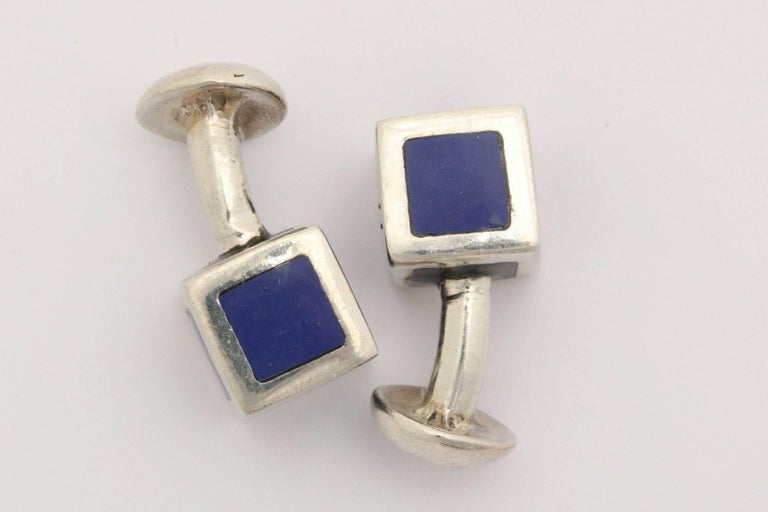Blue enamel inset on silver cube with circle fastener.