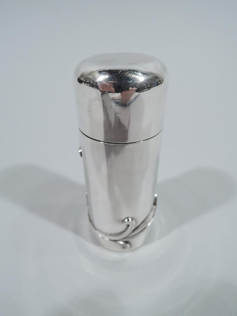 Turn-of-the-century Art Nouveau sterling silver vanity box. Made by William B. Kerr in Newark. Cylindrical with snug-fitting cover. Flower with fluid and whiplash wraparound stem applied to body. Fully marked and numbered 1379. Weight: 2 troy ounces.