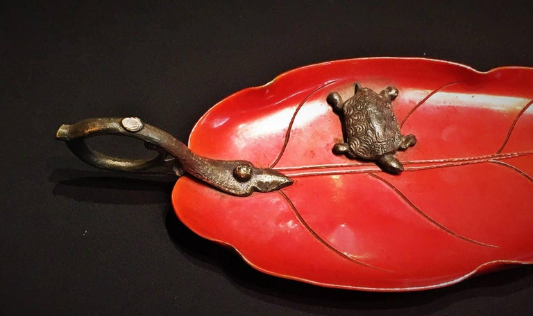 This beautiful terracotta-color lacquered brass jewelry tray in the form of a leaf is tastefully embellished with a patinated bronze handle in form of a branch and a miniature turtle and a fly.