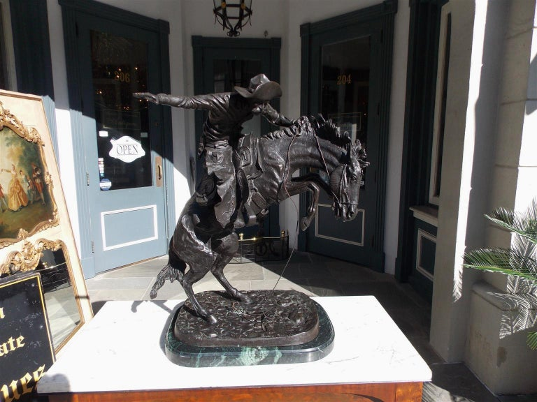 American Bronze and Marble Sculpture of Bronco Buster, F. Remington, Circa 1940 In Excellent Condition For Sale In Charleston, SC