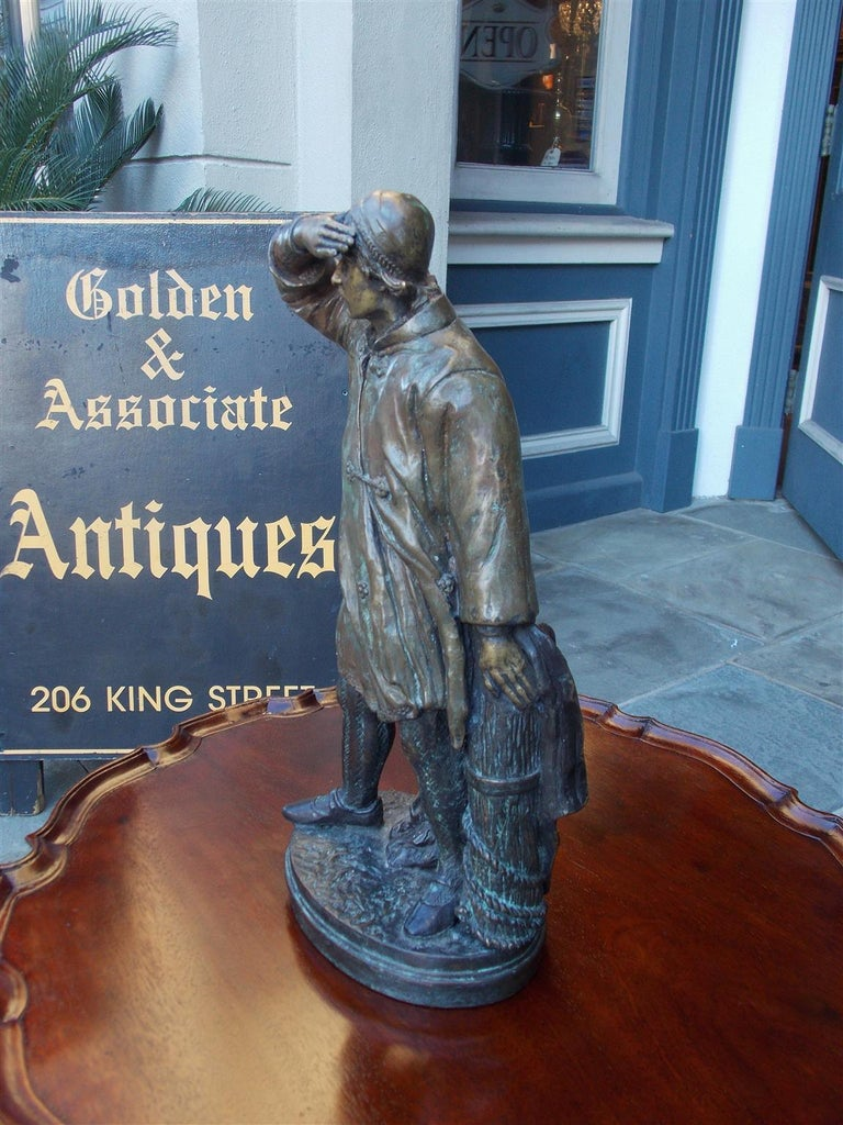 Cast American Bronze Sea Mariner Bracing on Rope Piling Mounted to Oval Base. C. 1870 For Sale