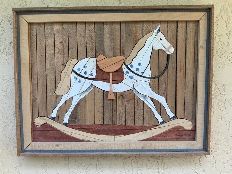 Beautiful wall hanging made of carved wood, hand painted mosaic pieces of wood depicting A children's rocking horse, rustic, countryside. Artist signature bottom right.