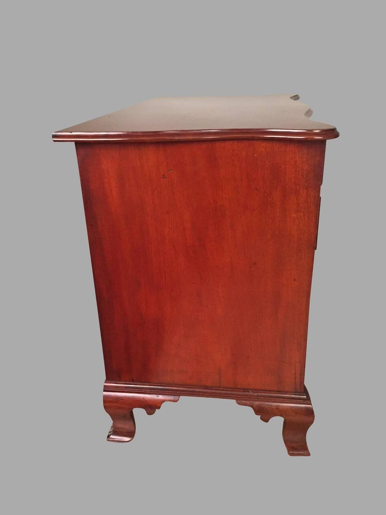 An American mahogany serpentine form Chippendale chest, the overhanging shaped top with a molded edge above four graduated drawers supported on tall ogee bracket feet. Probably mid-Atlantic states, circa 1770.