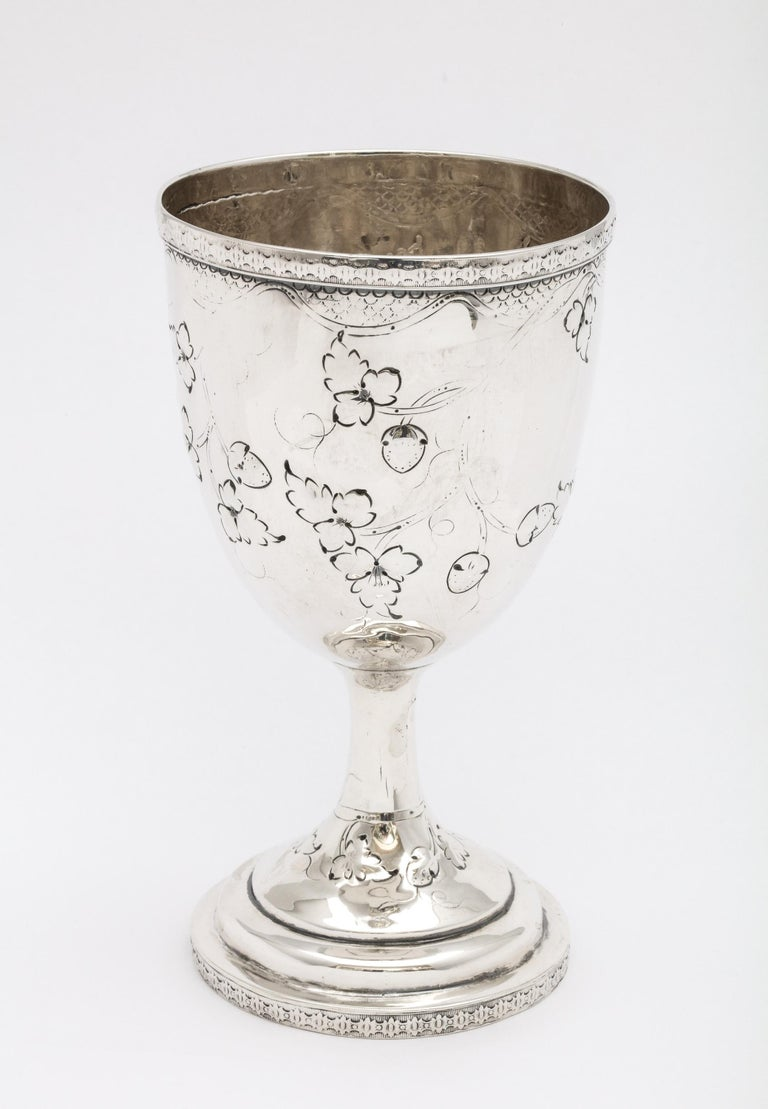 American coin silver (.900) goblet, Philadelphia, Ca. 1850's, Peter L. Krider - maker. Measures 6 inches high x 3 inches diameter across opening x 3 inches diameter across base. Decorated with garlands, leaves, fruit, etc. Weighs 3.810 troy ounces.