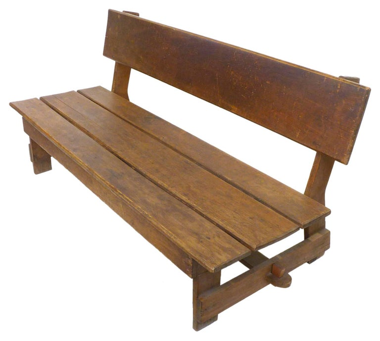 An exceptional American craft wood slat bench. An elegant, perfectly simple, utilitarian construction primarily of plain, cut boards with decorative, through-mortise-and-tenon joint at the cross-stretcher. Great from all angles with wonderful scale