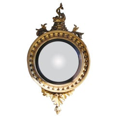 American Federal Gilt and Ebonized Dolphin Foliage Convex Mirror. Circa 1800