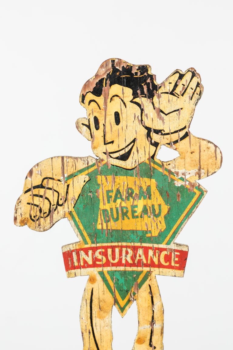 Great looking cartoon Midwestern Americana weathervane. Farm Bureau Insurance started in 1921. This great piece most likely was a premium or advertising piece. Hand painted wood with iron arrow. Presented on custom iron museum stand.
